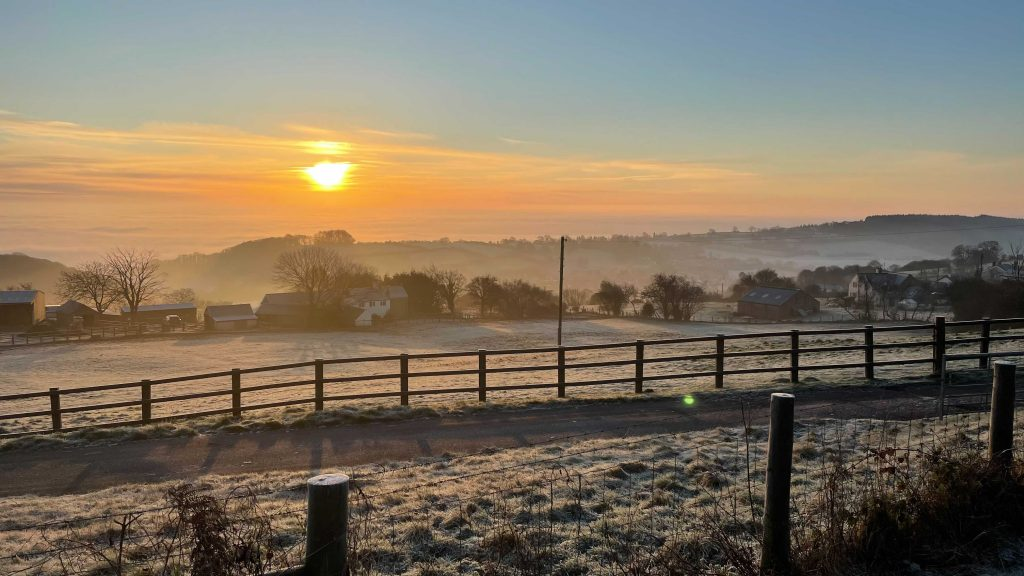 A frosty sunrise in the Forest of Dean with mist over the River Severn.